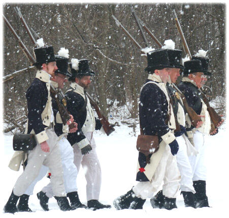 Troops marching in the snow as might have during the Battle of the River Raisin.